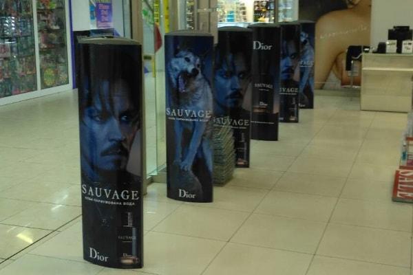 Брендирование, рекламное оформление противокражных систем в торговом центре, магазине