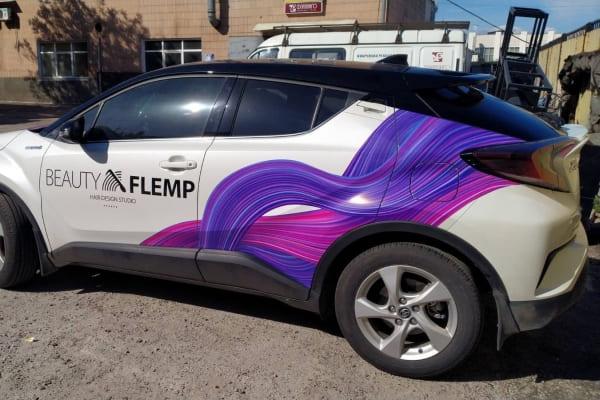 Оклейка, нанесение логотипа, рекламное брендирование легкового автомобиля